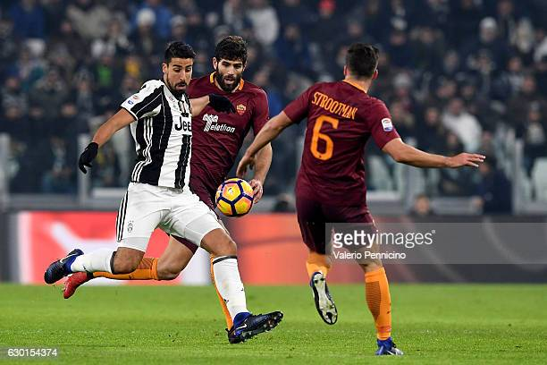 Sami Khedira of Juventus FC in action against Federico Fazio of AS Roma during the Serie A match between Juventus FC and AS Roma at Juventus Stadium...