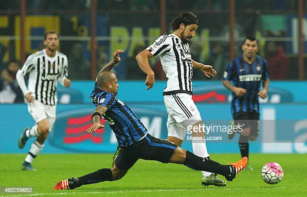 Sami Khedira of Juventus FC is challenged by Felipe Melo of FC Internazionale Milano during the Serie A match between FC Internazionale Milano and...