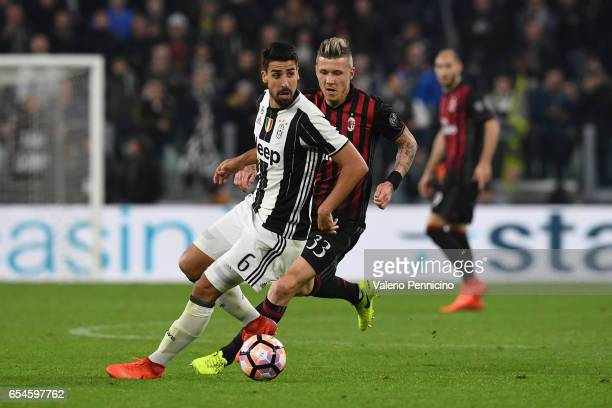 Sami Khedira of Juventus FC is challenged by Juraj Kucka of AC Milan during the Serie A match between Juventus FC and AC Milan at Juventus Stadium on...
