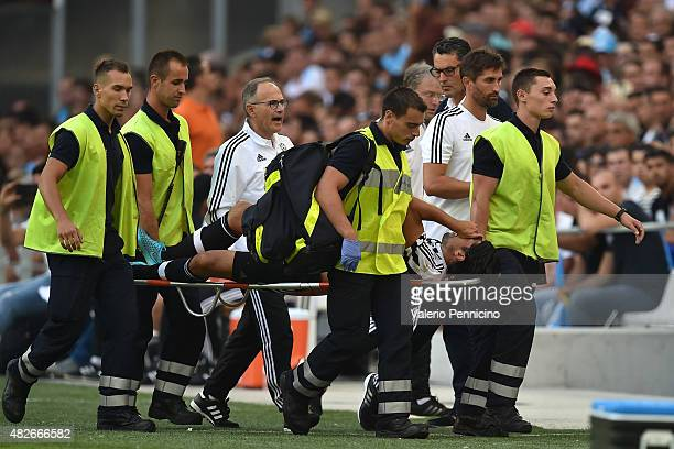 Sami Khedira of Juventus FC is helped from the pitch after sustaining an injury during the preseason friendly match between Olympique de Marseille...