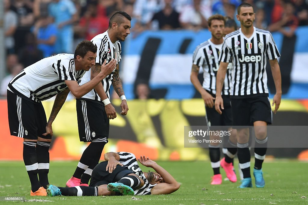 <a gi-track='captionPersonalityLinkClicked' href=/galleries/search?phrase=Sami+Khedira&family=editorial&specificpeople=2513712 ng-click='$event.stopPropagation()'>Sami Khedira</a> (C) of Juventus FC lies injured during the preseason friendly match between Olympique de Marseille and Juventus FC at Stade Velodrome on August 1, 2015 in Marseille, France.