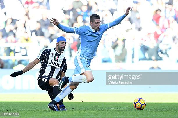Sami Khedira of Juventus FC tackles Sergej Milinkovic of SS Lazio during the Serie A match between Juventus FC and SS Lazio at Juventus Stadium on...