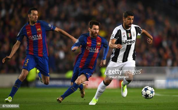 Sami Khedira of Juventus gets away from Lionel Messi of Barcelona during the UEFA Champions League Quarter Final second leg match between FC...