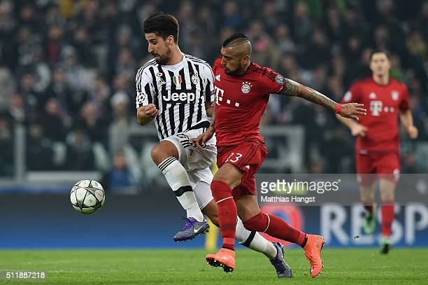 Sami Khedira of Juventus holds off the challenge from Arturo Vidal of Bayern Muenchen during the UEFA Champions League round of 16 first leg match...