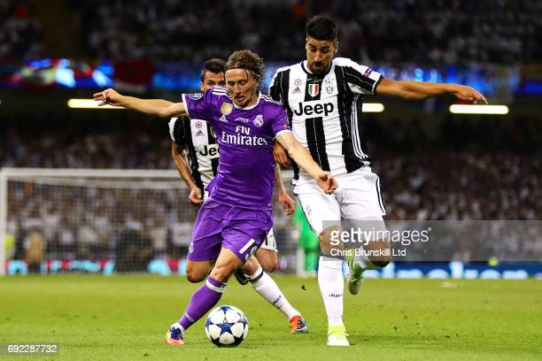 Sami Khedira of Juventus in action with Luka Modric of Real Madrid during the UEFA Champions League Final match between Juventus and Real Madrid at...