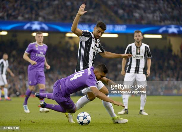 Sami Khedira of Juventus is challenged by Casemiro of Real Madrid during the UEFA Champions League Final between Juventus and Real Madrid at National...