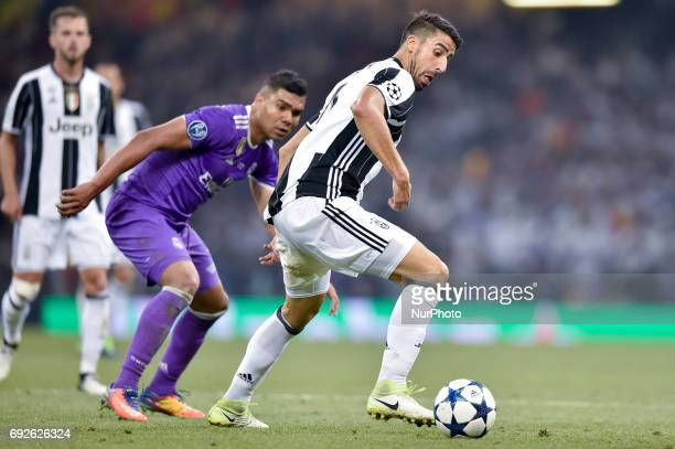 Sami Khedira of Juventus is challenged by Raphael Varane of Real Madrid during the UEFA Champions League Final match between Real Madrid and Juventus...