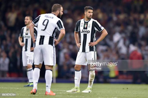 Sami Khedira of Juventus looks disappointed during the UEFA Champions League Final match between Real Madrid and Juventus at the National Stadium of...