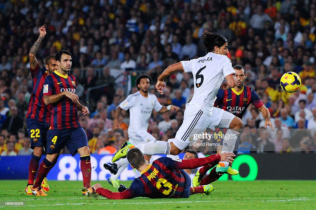 Sami Khedira of Real Madrid CF duels for the ball with Gerard Pique of FC Barcelona the La Liga match between FC Barcelona and Real Madrid CF at Camp Nou on October 26, 2013 in Barcelona, Spain.