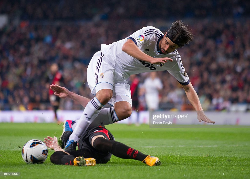 <a gi-track='captionPersonalityLinkClicked' href=/galleries/search?phrase=Sami+Khedira&family=editorial&specificpeople=2513712 ng-click='$event.stopPropagation()'>Sami Khedira</a> (R) of Real Madrid CF is tackled by Javi Fuego of Rayo Vallecano during the La Liga match between Real Madrid CF and Rayo Vallecano at estadio Santiago Bernabeu on February 17, 2013 in Madrid, Spain.