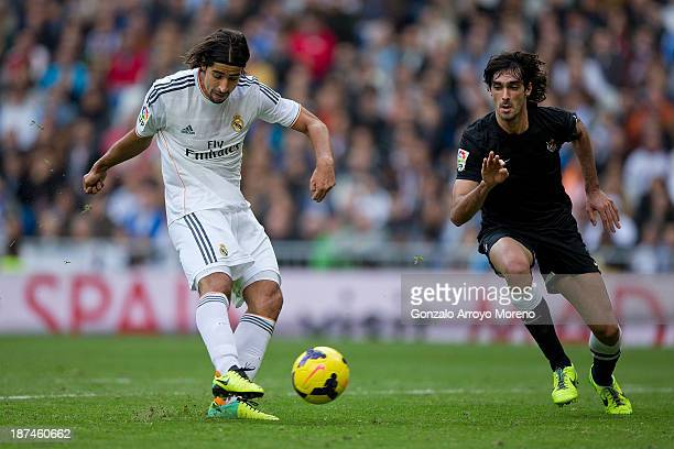 Sami Khedira of Real Madrid CF scores their fourth goal against Carlos Martinez of Real Sociedad during the La Liga match between Real Madrid CF and...