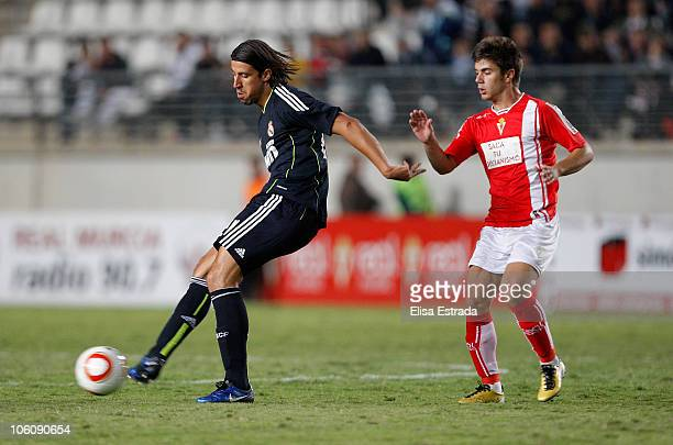 Sami Khedira of Real Madrid is chased by Ruben Rosquete of Real Murcia during the Copa del Rey match between Real Murcia and Real Madrid at Nueva...