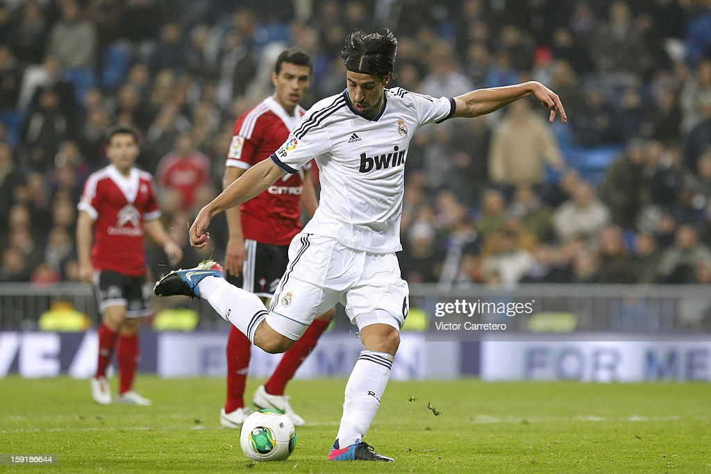 Sami Khedira of Real Madrid scores Real's fouth goal during the Copa del Rey round of 16 second leg match between Real Madrid and Celta de Vigo at Estadio Santiago Bernabeu on January 9, 2013 in Madrid, Spain.