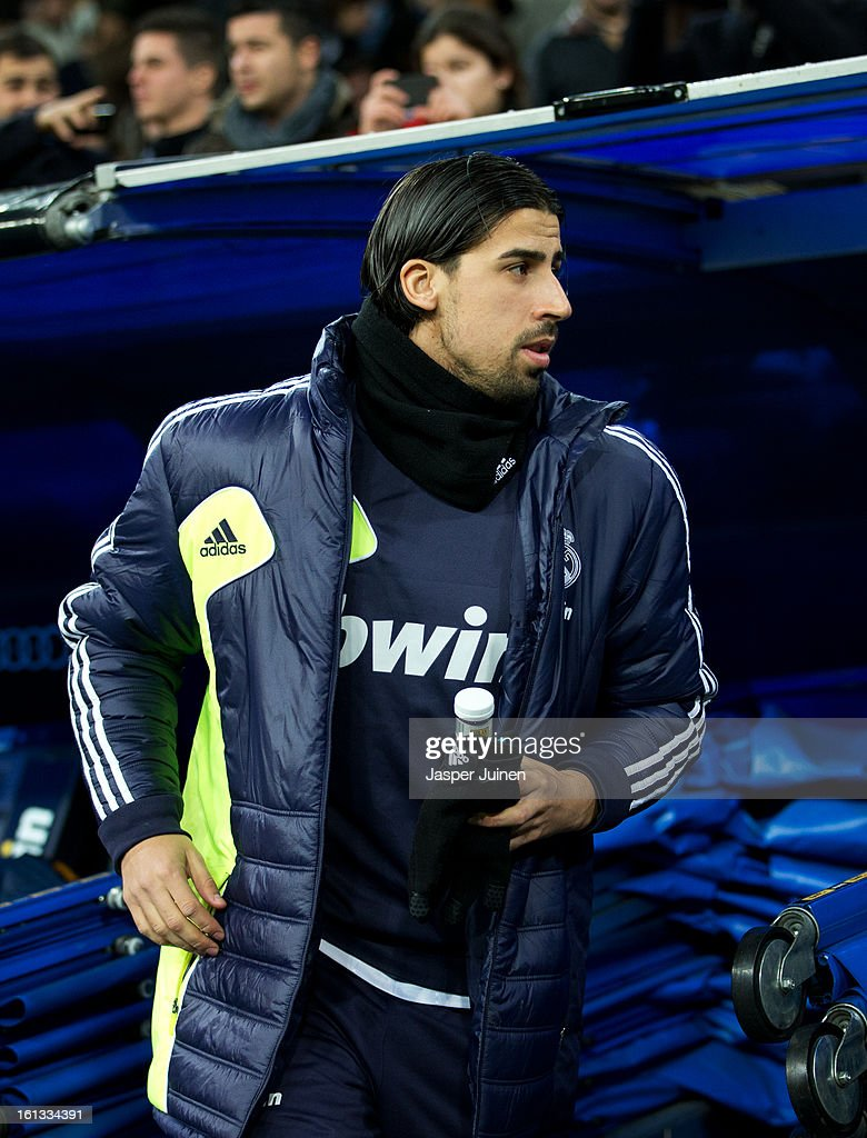 <a gi-track='captionPersonalityLinkClicked' href=/galleries/search?phrase=Sami+Khedira&family=editorial&specificpeople=2513712 ng-click='$event.stopPropagation()'>Sami Khedira</a> of Real Madrid takes his place on the bench prior to the start of the la Liga match between Real Madrid CF and Sevilla FC at Estadio Santiago Bernabeu on February 9, 2013 in Madrid, Spain.