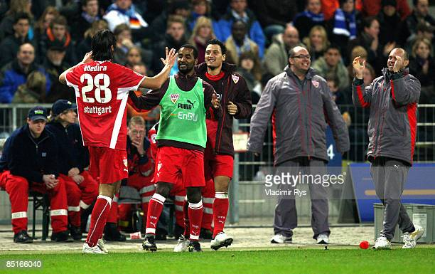 Sami Khedira of Stuttgart celebrates with his team mate Cacau after scoring the 02 goal against keeper Markus Miller of Karlsruhe during the...