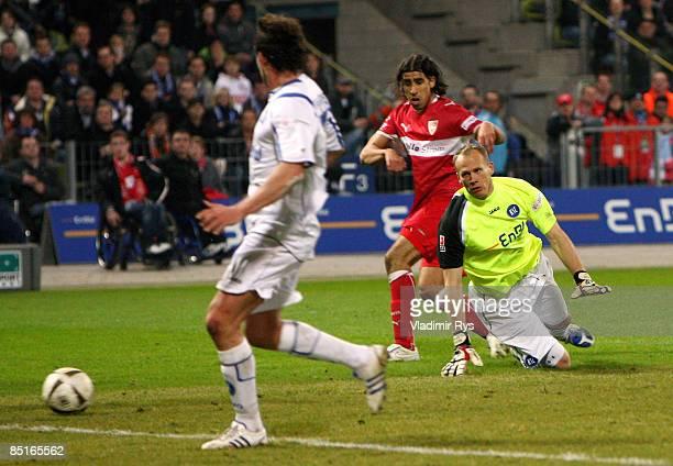 Sami Khedira of Stuttgart scores the 02 goal against keeper Markus Miller of Karlsruhe during the Bundesliga match between Karlsruher SC and VfB...