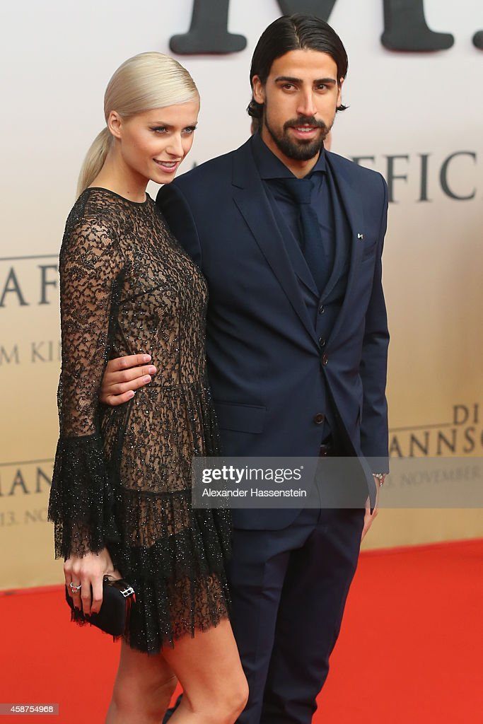 <a gi-track='captionPersonalityLinkClicked' href=/galleries/search?phrase=Sami+Khedira&family=editorial&specificpeople=2513712 ng-click='$event.stopPropagation()'>Sami Khedira</a> of the German national football team arrives with <a gi-track='captionPersonalityLinkClicked' href=/galleries/search?phrase=Lena+Gercke&family=editorial&specificpeople=579958 ng-click='$event.stopPropagation()'>Lena Gercke</a> for the movie premiere 'Die Mannschaft' at Sony Center Berlin on November 10, 2014 in Berlin, Germany.