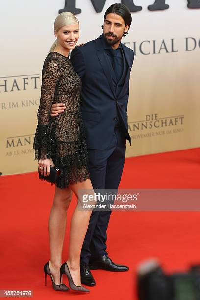 Sami Khedira of the German national football team arrives with Lena Gercke for the movie premiere 'Die Mannschaft' at Sony Center Berlin on November...