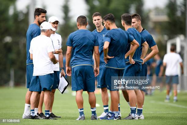 Sami Khedira Simone Folletti Rodrigo Bentancur of Juventus during a training session on July 9 2017 in Vinovo Italy