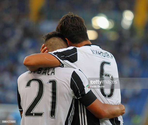 Sami Khedira with his teammate Paulo Bruno Exequiel Dybala of Juventus FC celebrates after scoring the opening goal during the Serie A match between...