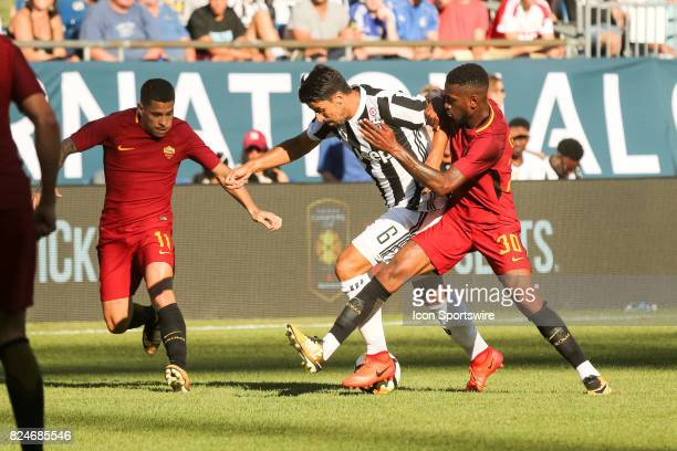 Sami Khediri of Juventus and Gerson of AS Roma battle for the ball during the International Champions Cup match between Juventus and AS Roma on July...