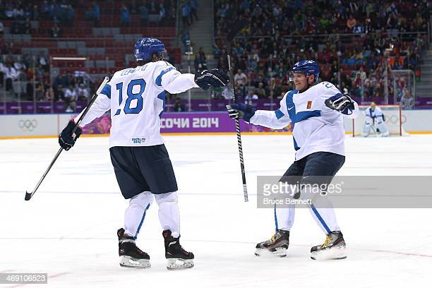 Sami Lepisto of Finland celebrates with teammate Petri Kontiola after scoring a goal in the first period against Bernhard Starkbaum of Austria during...