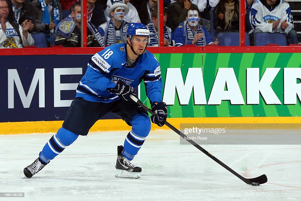 <a gi-track='captionPersonalityLinkClicked' href=/galleries/search?phrase=Sami+Lepisto&family=editorial&specificpeople=2533741 ng-click='$event.stopPropagation()'>Sami Lepisto</a> of Finland skates with the puck during the IIHF World Championship group H match between Latvia and Finland at Hartwall Areena on May 14, 2013 in Helsinki, Finland.