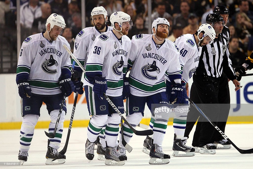 Sami Salo Andrew Alberts Jannik Hansen Raffi Torres and Maxim Lapierre of the Vancouver Canucks look on towards the end Game Three against the Boston...