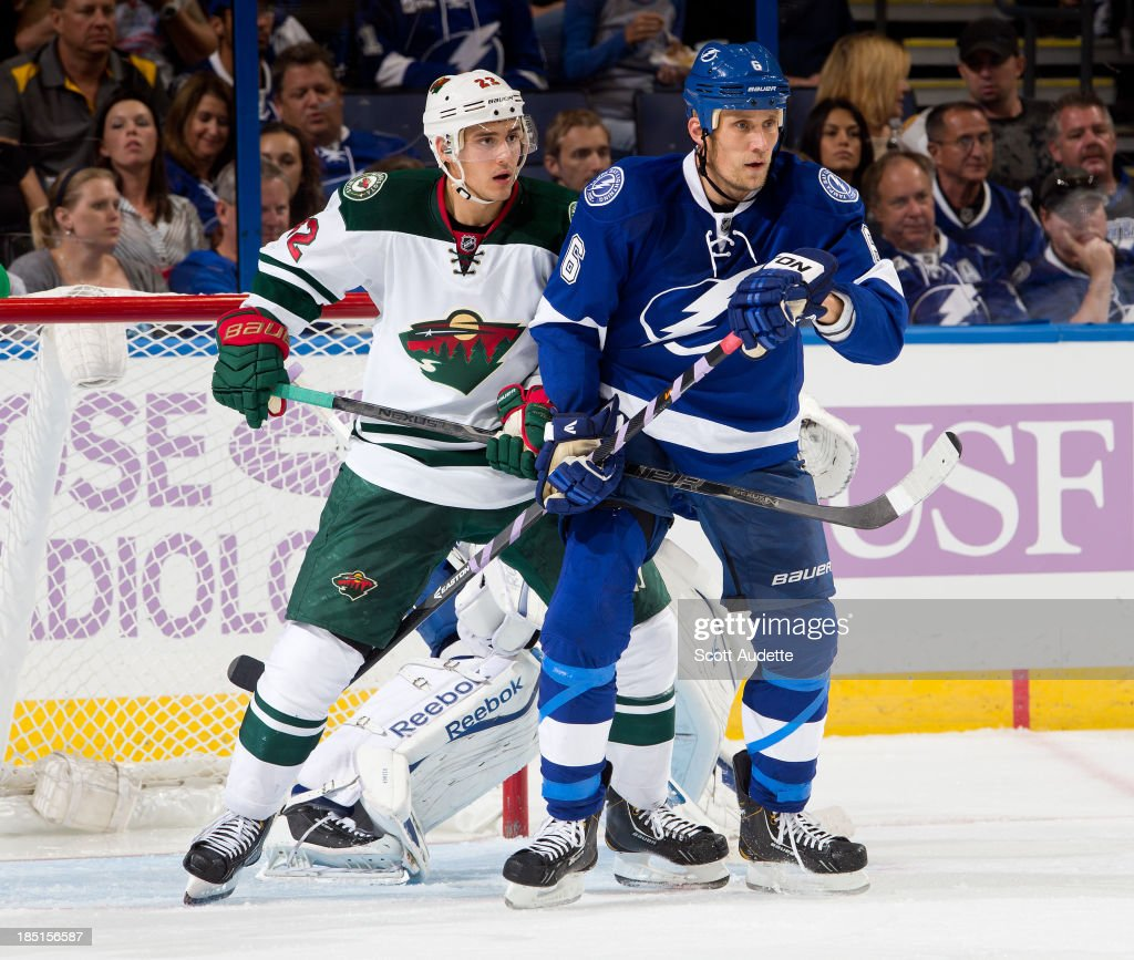 <a gi-track='captionPersonalityLinkClicked' href=/galleries/search?phrase=Sami+Salo&family=editorial&specificpeople=206132 ng-click='$event.stopPropagation()'>Sami Salo</a> #6 of the Tampa Bay Lightning battles in front of the net with <a gi-track='captionPersonalityLinkClicked' href=/galleries/search?phrase=Nino+Niederreiter&family=editorial&specificpeople=6667732 ng-click='$event.stopPropagation()'>Nino Niederreiter</a> #22 of the Minnesota Wild during the second period at the Tampa Bay Times Forum on October 17, 2013 in Tampa, Florida.