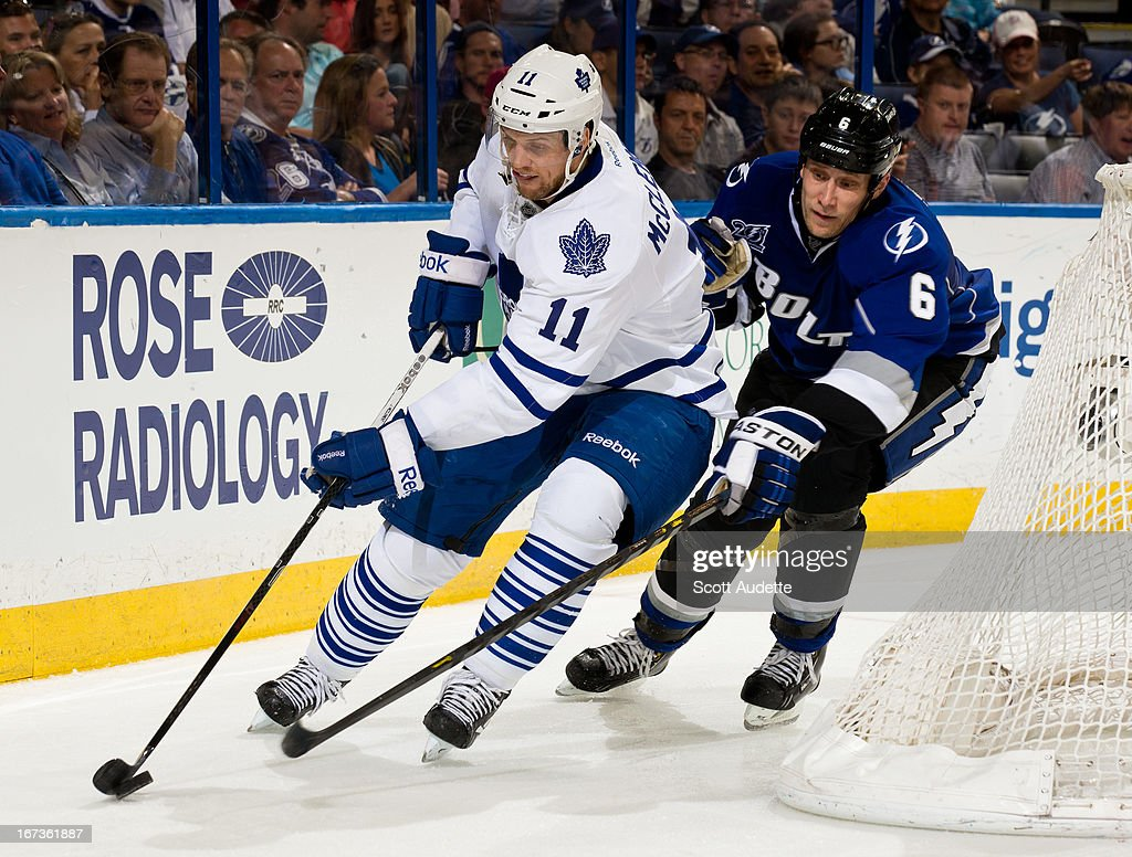 <a gi-track='captionPersonalityLinkClicked' href=/galleries/search?phrase=Sami+Salo&family=editorial&specificpeople=206132 ng-click='$event.stopPropagation()'>Sami Salo</a> #6 of the Tampa Bay Lightning pursues <a gi-track='captionPersonalityLinkClicked' href=/galleries/search?phrase=Jay+McClement&family=editorial&specificpeople=575233 ng-click='$event.stopPropagation()'>Jay McClement</a> #11 of the Toronto Maple Leafs during the second period of the game at the Tampa Bay Times Forum on April 24, 2013 in Tampa, Florida.