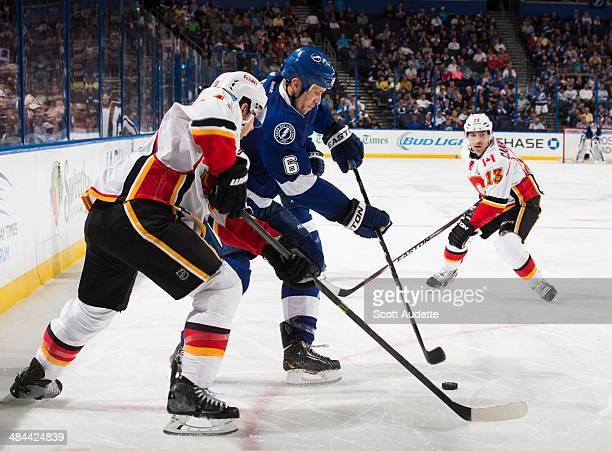 Sami Salo of the Tampa Bay Lightning skates against Mikael Backlund of the Calgary Flames during the third period at the Tampa Bay Times Forum on...