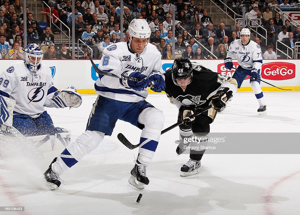 Sami Salo #6 of the Tampa Bay Lightning watches the loose puck while battling for position against Tyler Kennedy #48 of the Pittsburgh Penguins on March 4, 2013 at Consol Energy Center in Pittsburgh, Pennsylvania.