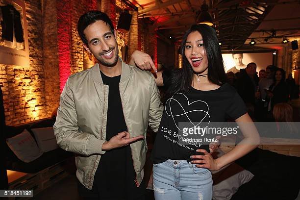 Sami Slimani and Anuthida Ploypetch attend the REVIEW by Sami Slimani Capsule Collection launch party on March 31 2016 in Duesseldorf Germany