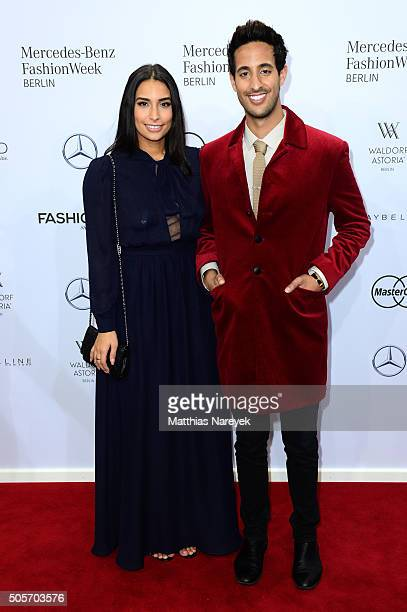 Sami Slimani and Dounia Slimani attend the Riani show during the MercedesBenz Fashion Week Berlin Autumn/Winter 2016 at Brandenburg Gate on January...
