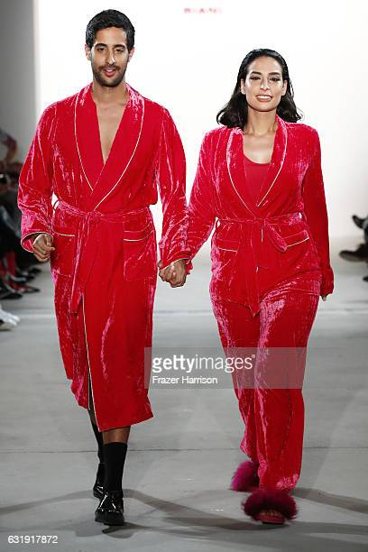 Sami Slimani and Lamiya Slimani walks the runway at the Riani show during the MercedesBenz Fashion Week Berlin A/W 2017 at Kaufhaus Jandorf on...