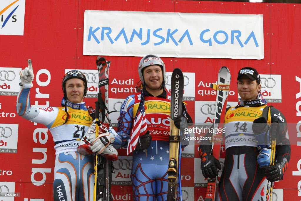 Sami Uotila of Finland, 2nd place, Bode Miller of the USA, 1st place, and Christian Mayer of Austria, 3rd place, celebrate at the podium after the Men's Giant Slalom on January 4, 2003 at the FIS World Cup in Kranjska Gora, Slovenia.