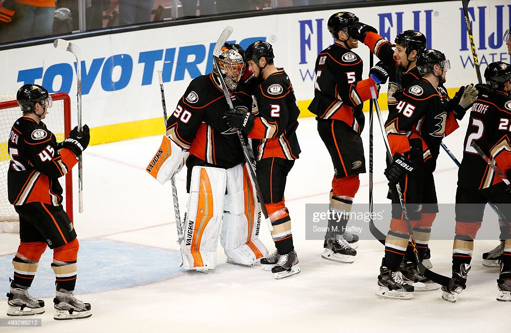 <a gi-track='captionPersonalityLinkClicked' href=/galleries/search?phrase=Sami+Vatanen&family=editorial&specificpeople=5894626 ng-click='$event.stopPropagation()'>Sami Vatanen</a> #45, <a gi-track='captionPersonalityLinkClicked' href=/galleries/search?phrase=Kevin+Bieksa&family=editorial&specificpeople=688792 ng-click='$event.stopPropagation()'>Kevin Bieksa</a> #2, <a gi-track='captionPersonalityLinkClicked' href=/galleries/search?phrase=Korbinian+Holzer&family=editorial&specificpeople=10837049 ng-click='$event.stopPropagation()'>Korbinian Holzer</a> #5, Jiri Sekac #46 and <a gi-track='captionPersonalityLinkClicked' href=/galleries/search?phrase=Shawn+Horcoff&family=editorial&specificpeople=239536 ng-click='$event.stopPropagation()'>Shawn Horcoff</a> #22 of the of the Anaheim Ducks congratulate <a gi-track='captionPersonalityLinkClicked' href=/galleries/search?phrase=Anton+Khudobin&family=editorial&specificpeople=722106 ng-click='$event.stopPropagation()'>Anton Khudobin</a> #30 after the 4-1 win over the Minnesota Wild in a game at Honda Center on October 18, 2015 in Anaheim, California.