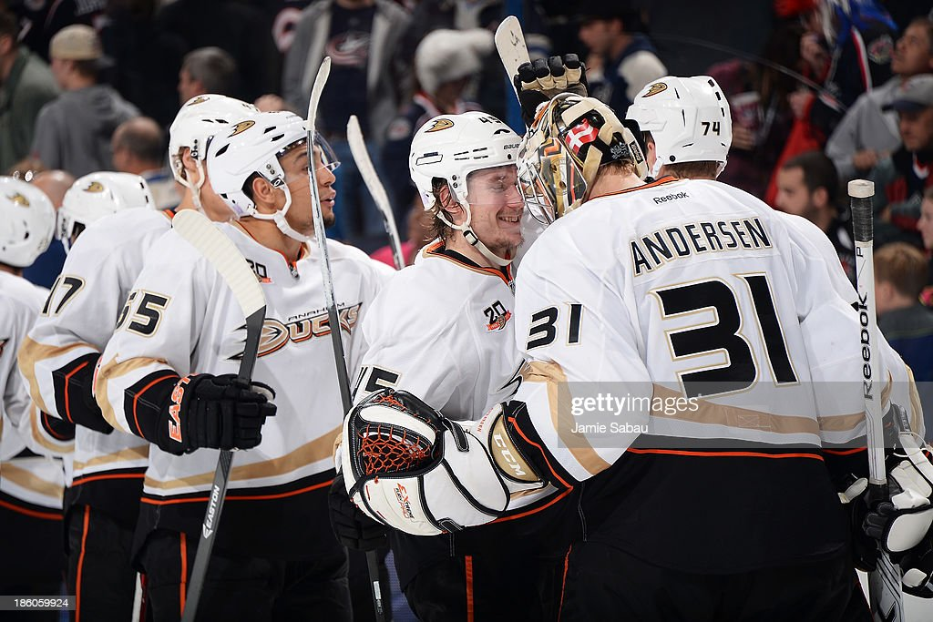 <a gi-track='captionPersonalityLinkClicked' href=/galleries/search?phrase=Sami+Vatanen&family=editorial&specificpeople=5894626 ng-click='$event.stopPropagation()'>Sami Vatanen</a> #45 of the Anaheim Ducks celebrates with goaltender Frederik Andersen #31 of the Anaheim Ducks after defeating the Columbus Blue Jackets 4-3 on October 27, 2013 at Nationwide Arena in Columbus, Ohio.