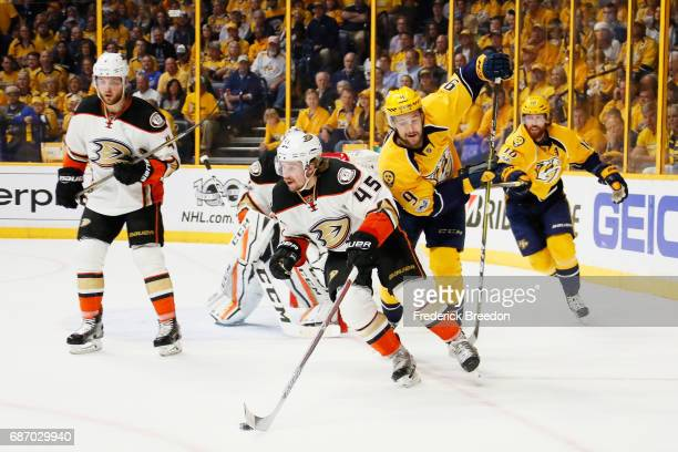 Sami Vatanen of the Anaheim Ducks controls the puck against Filip Forsberg of the Nashville Predators in Game Six of the Western Conference Final...
