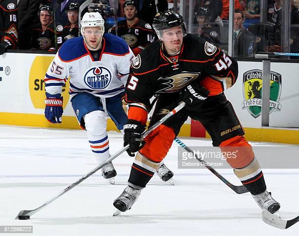 Sami Vatanen of the Anaheim Ducks handles the puck against Mark Letestu of the Edmonton Oilers on February 26 2016 at Honda Center in Anaheim...