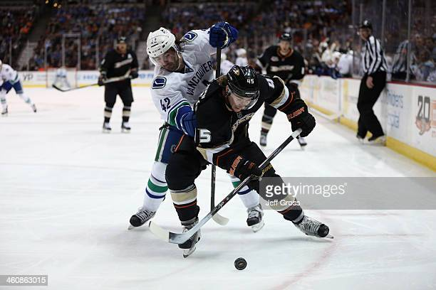 Sami Vatanen of the Anaheim Ducks is pursued by Benn Ferriero of the Vancouver Canucks for the puck in the second period at Honda Center on January 5...