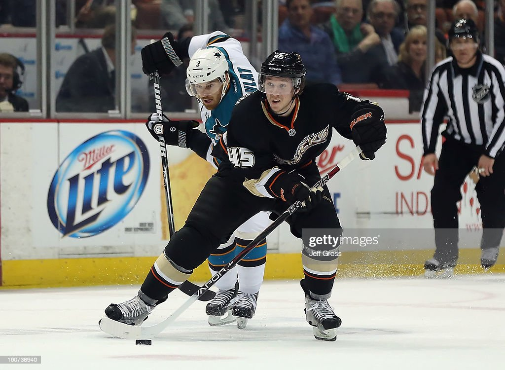 Sami Vatanen #45 of the Anaheim Ducks is pursued by <a gi-track='captionPersonalityLinkClicked' href=/galleries/search?phrase=Martin+Havlat&family=editorial&specificpeople=202654 ng-click='$event.stopPropagation()'>Martin Havlat</a> #9 of the San Jose Sharks for the puck in the first period at Honda Center on February 4, 2013 in Anaheim, California. The Ducks defeated the Sharks 2-1.