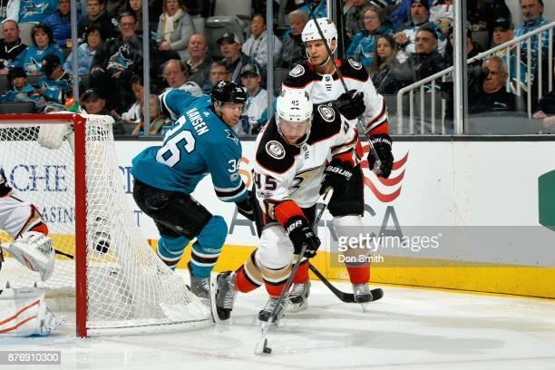 Sami Vatanen of the Anaheim Ducks moves the puck ahead of Jannik Hansen of the San Jose Sharks and Kevin Bieksa of the Anaheim Ducks at SAP Center on...
