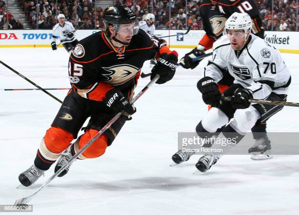 Sami Vatanen of the Anaheim Ducks skates with the puck against Tanner Pearson of the Los Angeles Kings during the game on April 9 2017 at Honda...