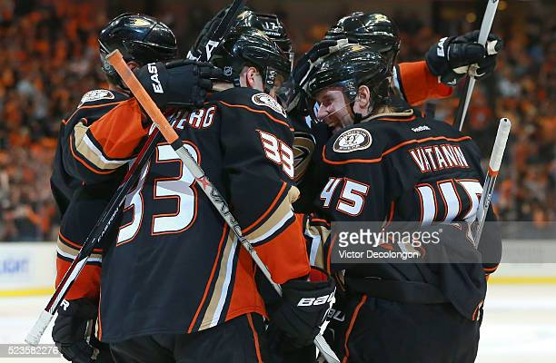Sami Vatanen of the Anaheim Ducks smiles as he celebrates with Jakob Silfverberg and his Ducks teammates after scoring on a breakaway against...