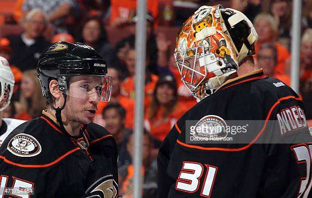 Sami Vatanen of the Anaheim Ducks talks with Ducks goalie Frederik Andersen during a break in the action in the second period against the Calgary...