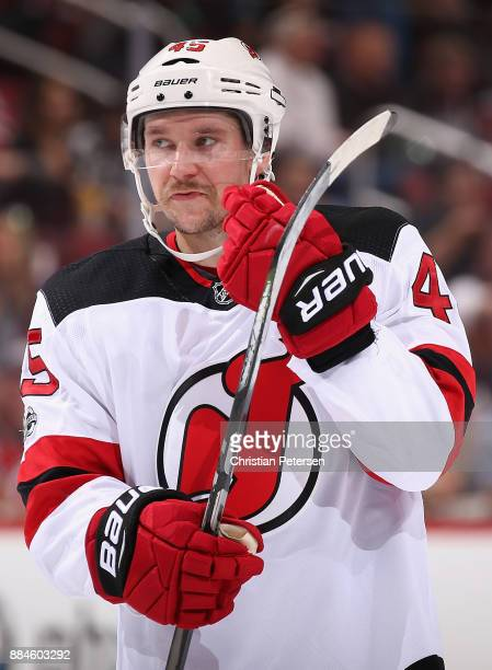 Sami Vatanen of the New Jersey Devils awaits a face off during the second period of the NHL game against the Arizona Coyotes at Gila River Arena on...