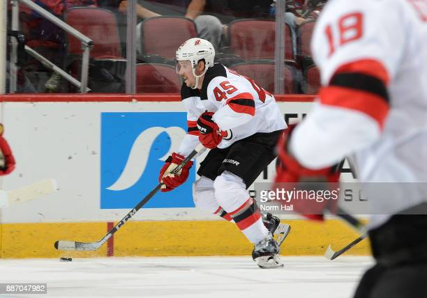 Sami Vatanen of the New Jersey Devils skates with the puck against the Arizona Coyotes at Gila River Arena on December 2 2017 in Glendale Arizona