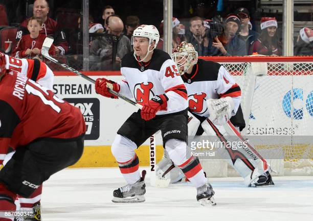 Sami Vatanen of the New Jersey Devils stands in front of his own net while looking for the puck against the Arizona Coyotes at Gila River Arena on...