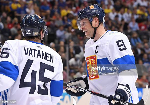 Sami Vatanen talks with Mikko Koivu of Team Finland between whistles during the World Cup of Hockey 2016 at Air Canada Centre on September 20 2016 in...